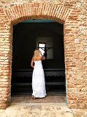 Beautiful Blonde Girl Near A Cross Of Jesus. The Door To Jesus. poster