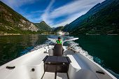 Man driving a motor boat. Geiranger fjord, Beautiful Nature Norway.Summer vacation. Geiranger Fjord, poster