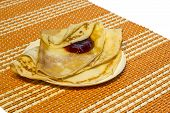 Pancakes With Oil And Crimson Jam On A White Plate.