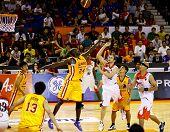 KUALA LUMPUR - FEBRUARY 19: Slingers L. Graham (24) tries to block Dragons Ernani Pacana's (22) shot at an ASEAN Basketball League match on February 19, 2012 in Kuala Lumpur. Dragons won 86-71.