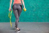 Diet. Healthy Happy Female With Apple And Tape Measure For Diet And Weight Loss Concept - Isolated O poster
