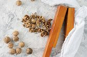Process Of Cracking Hazelnuts And Walnuts Cracking With A Special Wooden Tool, Healthy Nuts poster