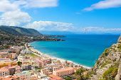 Paraglider Flying Above The Amazing Landscape Of Coastal City Cefalu In Beautiful Sicily. Paraglidin poster