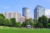 BOSTON, MA - JUN 18: People play games in Boston Common on June 18, 2011, Boston, Massachusetts. It is the oldest city park in the US and was declared a U.S. National Historic Landmark in 1987.