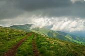 Trekking On Mountain Peaks. Lonely Road In Mountain Landscape. Traveling In Nature. Travel Outdoor B poster