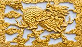 foto of chinese unicorn  - Golden dragon - JPG