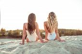 Two Girlfriends Woman Long Hair, View From Back, Girls Sisters, Sit Sunbathe Summer Beach White Sand poster