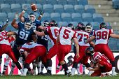 GRAZ, AUSTRIA - JULY 9: K Lirim Hajrullahu (#5 Canada) kicks a PAT at the Football World Championshi