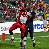 GRAZ, AUSTRIA - JULY 9 WR Shamawd Chambers (#84 Canada) catches the ball at the Football World Championship on July 9, 2011 in Graz, Austria. Canada wins 45:10 against France.