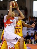 KUALA LUMPUR - FEBRUARY 19: Malaysian Dragons' Brian Williams attempts a shot against Singapore Slingers at the ASEAN Basketball League match on February 19, 2012 in Kuala Lumpur, Malaysia. Dragons won 86-71.