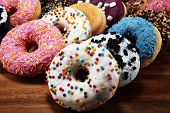 Donuts In Different Glazes With Chocolate poster