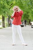 Time To Fun. Little Child Have Fun Doing Glasses Gesture Outdoor. Small Girl Enjoying Summer Fun. Fu poster