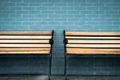 Empty Two Wooden Bench On Green Brick Wall Background. Waiting For Someone To Full Fill Empty Wooden poster
