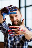 Artist Delight Imagination Inspiration. Smiling Painter Looking At Camera. Hands Frame With Red Blue poster