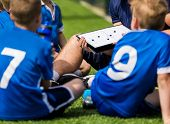 Children During Soccer Football Coaching Session. Boys In Soccer Team Listening To Coach. Coach Of Y poster