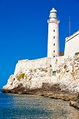 stock photo of el morro castle  - Vertical shot of the famous castle and lighthouse of El Morro - JPG