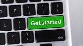 Start. Computer Keyboard With Green Get Started Button poster