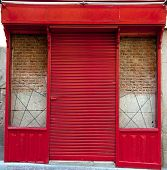 Retro shop with shutters down