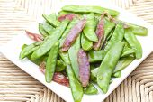 Sauted sausage and snow peas
