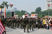 KUALA LUMPUR - AUGUST 31: Paratroopers from the 10th Airborne Brigade parade on the city streets cel