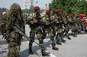 KUALA LUMPUR - AUGUST 31: Snipers and Recce scouts from the 10th Airborne Brigade march on the city
