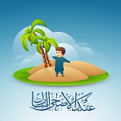 Happy cute little Muslim boy in traditional dress with Arabic Islamic calligraphy of text Eid Al Azh