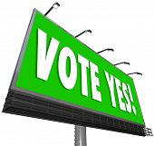 Vote Yes words on a big green outdoor billboard to encourage you to approve, affirm or accept a cand