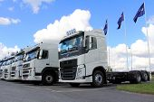White Volvo Trucks in a Row