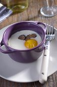 Baked egg with sliced truffle in a cocotte