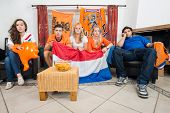 Dissillusioned Dutch sports fans watching their national team loose on television