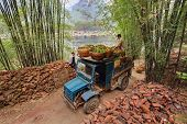 Vintage Blue Truck, Laden Of Oranges In Wicker Baskets, China.