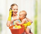 Young Happy Mother Is A Housewife With A Baby Does Homework And Talking On The Phone At Home