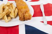Cropped shot of junk food over British flag