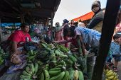 PADANG - AUGUST 25: A vendor sells banana and farm produce at her stall at a village market in Padang, Sumatera, Indonesia on August 25, 2013. Agriculture and fishery is an important industry here.