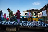 PADANG - AUGUST 25: Fishmongers wait for customers in a stall at an outdoor village market in Padang