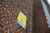 Fallout Shelter Sign On Red Brick Wall