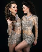 Excited Glamorous Couple In Platinum Dresses Talking