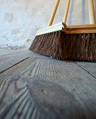 Large Brooms On Wooden Floor Housework