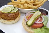 Crabcake Burger With French Fries Closeup