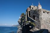 Ancient Castle Overhanging Blue Sea in Camogli