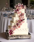 elaborate five tiered wedding cake with flowers