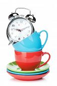 Coffee cups and alarm clock. Isolated on white background