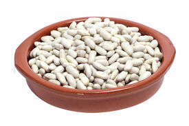 stock photo of phaseolus  - an earthenware bowl with dry white beans on a white background - JPG