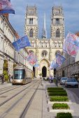ORLEANS, FRANCE - SEPTEMBER 10, 2013: View to Orleans Cathedral from the Rue Jeanne d'Arc decorated