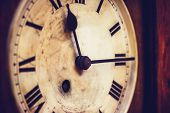 stock photo of pendulum clock  - Close up on a Old Grandfather Clock - JPG