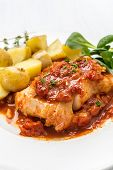 Plate of Cod or Pollack Cooked in Tomato and Thyme Sauce Garnished with Boiled New Potatoes