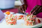 foto of conch  - Close up of Bahamian woman making traditional conch salad - JPG