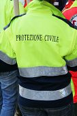 stock photo of messina  - Volunteer of Italin Protezione Civile at work during the Messina flood disaster - JPG