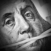 stock photo of gag  - Money keeps silent - JPG