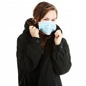 stock photo of swine flu  - A model wearing a mask to prevent  - JPG